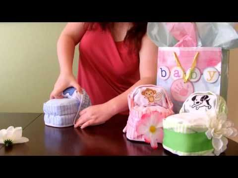 For around $10 and 10 minutes you can create this fun and unique diaper cake gift or decor for a baby shower. Using only 16 diapers and a handful of supplies, your guests will love these cute handmade decorations. Everything is reusable!    Bassinet made with washcloths tutorial: http://www.youtube.com/watch?v=lsZ7gg-FWgE    ♥ Closeout prices and $2...
