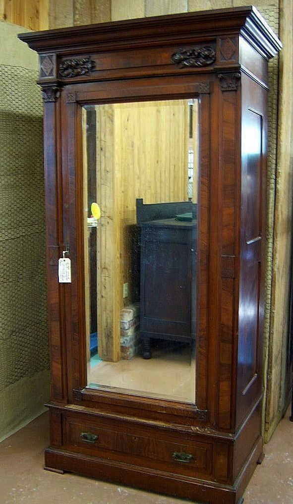 American Eastlake Victorian walnut single door wardrobe or armoire with a full beveled glass mirror in the door.  tasteful, deep and bold carvings