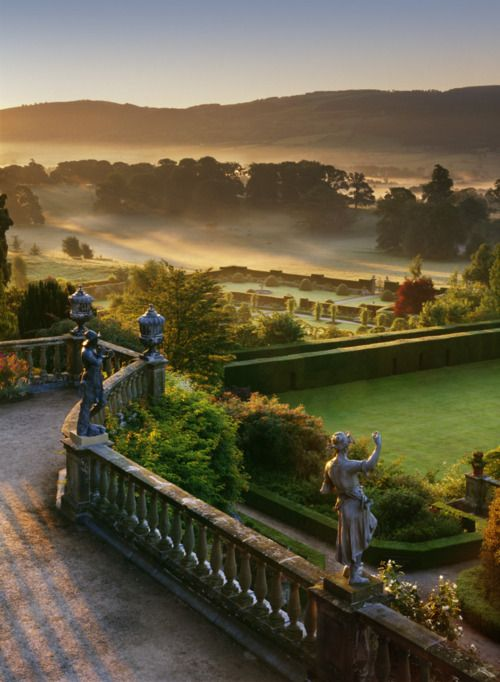 A beautifully misty view from the terraces of Powis Castle, Wales. The Edwardian gardens created by Lady Powis can be seen in the middle distance. ©NTPL/Andrew Butler