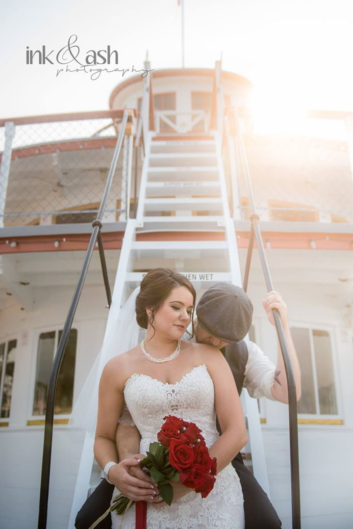 Bride and groom on stairs of the Sicamous. Photo by Ink and Ash Photography