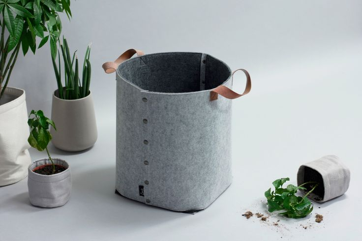 Design by Christine E. Sveen for Sne design. LAGRE felt storage basket in gray, with darker gray linin, and leather handles. Available at snedesign.com.