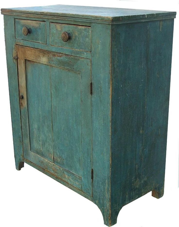 Early 19th century cupboard with original dry robin's egg blue paint, two dovetailed drawers over one single panel door, all full mortised and double pined, with a nice high country hepplewhite cut out foot, circa 1820 - from Country Treasures
