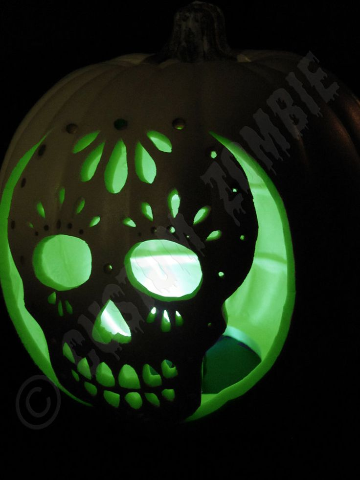 Groovy Dia de los Muertos / Day of the Dead pumpkin carving. Light it up with LED submersible lights - many colors, cheap, long lasting & safer than candles!: http://www.flashingblinkylights.com/ledsubmersiblecraftlights-c-114_462.html