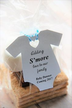 Adding S'more love to our family! A cute way to reveal you are pregnant! Blue Baby Boy coming soon! Smore Onesie shaped party favor gift tags at www.kendollmade.com