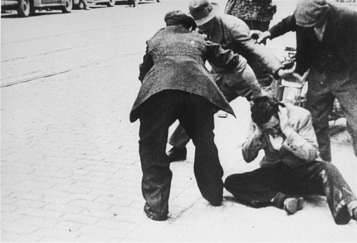 Civilians attack a Jewish man in a street in Riga, Latvia, July 1941.
