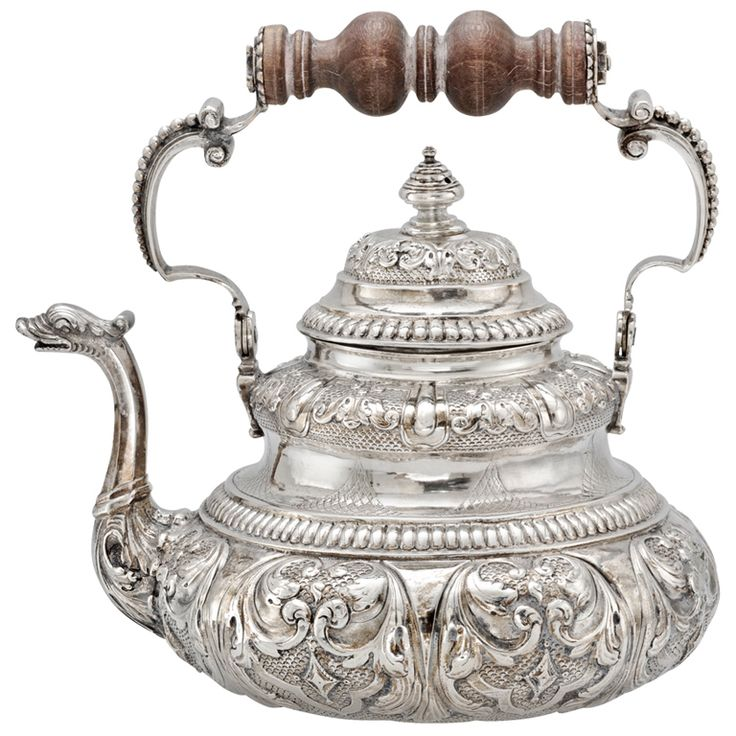 Dutch tea pot in silver with turned wooden handle and dolphin spout, circa 1730.