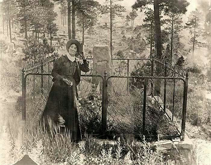 Calamity Jane at Wild Bill Hickok's grave Deadwood SD 1903