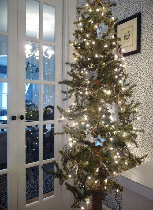 a tree decorated with cookie cutters for the kitchen.....great idea      via Bargain Hoots