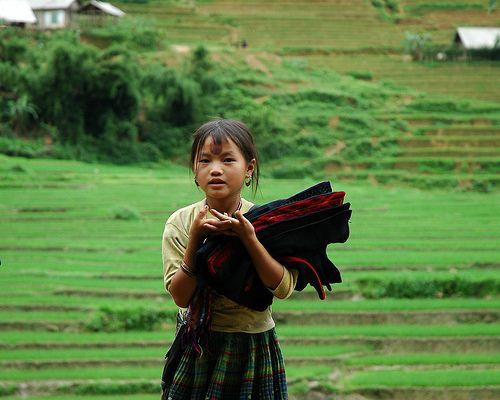 Hmong child hawker, Sapa, Vietnam by Hanoi Days,