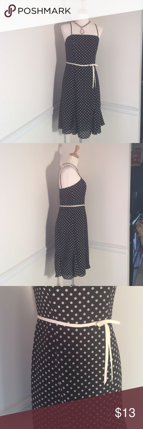"""Size 6 CDC vintage style polka dot dress This dress is sheer and super elegant. Whether for the office paired with a sweater or for a night out on the town this dress is sure to impress. Black with cream polka dots. Bow detail at the waist. 36"""" from top of strap to bottom of dress. 16 """" from pit to pit. 15 1/2"""" waist. cdc Dresses Strapless"""