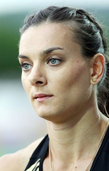 Yelena Isinbayeva Photos - Olympic champion Yelena Isinbayeva of Russia wins the pole-vault event at the International track-and-field meeting, held at the Stade Jean Adret in Sotteville-les-Rouen in Normandy. - Olympic champion Yelena Isinbayeva shows off her skill as she wins the pole vault event at the International Track and Field meeting in France