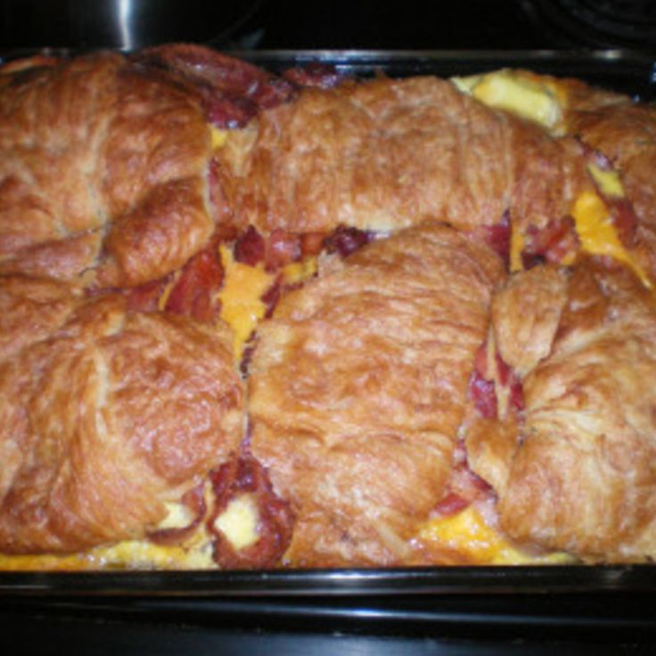 Flaky croissants, two kinds of cheese, bacon and eggs make up this scrumptious breakfast casserole. Perfect for a Sunday brunch to begin your day of watching football with some friends, for a potluck at the office, or for a fun family gathering at the breakfast table on the weekend. For whatever occasion, this is sure to be a big hit.
