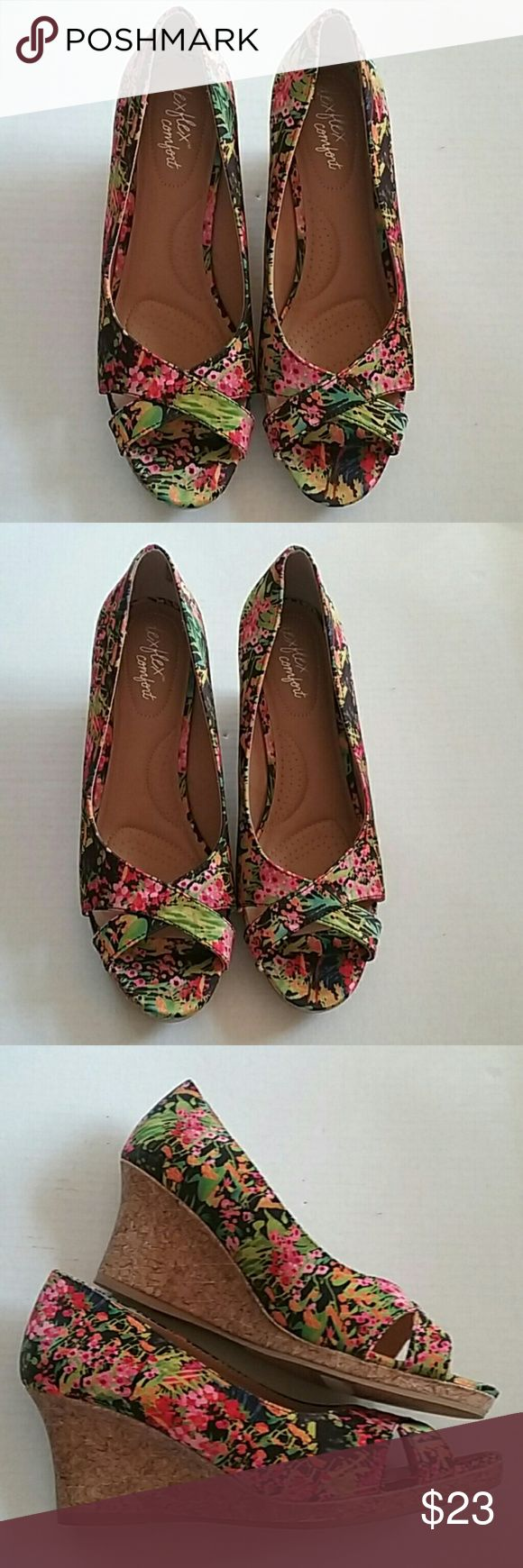 Dexflex comfort Floral summer platform wedge shoes This is a like new pair of Dexflex Wildly floral wedge platform sandals. I wear a true size 8 and they were comfortable on me.  THEY ARE IN LIKE NEW CONDITION.  Ladies size 8.5 Dexflex Shoes Sandals