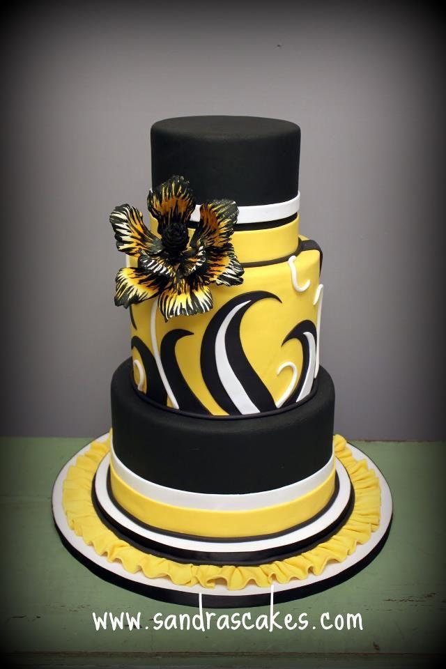 yellow and black wedding cake
