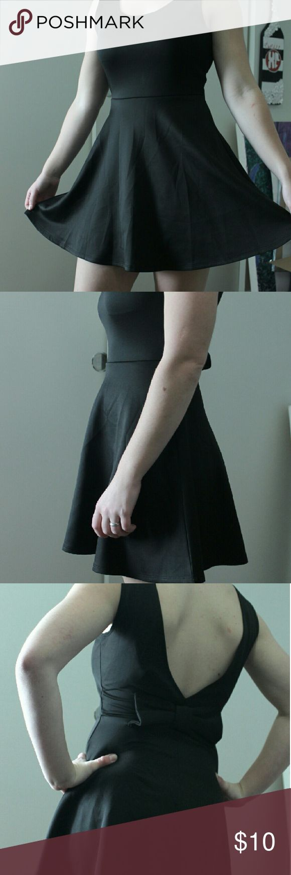 Black Skater Skirt Black Skater Skirt, low back, bow on the back. Like new, only worn once Wet Seal Dresses Midi