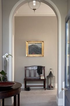 The wall paint is Walling: Rolling Fog 143 by Little Greene English Heritage. The archway and ceilings are Pointing 2003 by Farrow and Ball. The skirtings are Slipper Satin 2004 by Farrow and Ball.