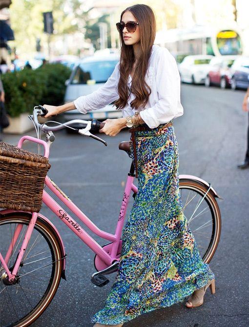 pink bike and a long skirt.