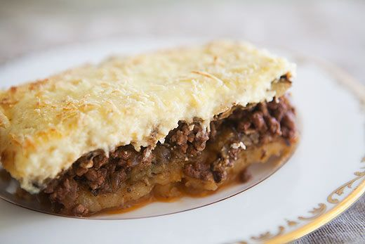 Moussaka ~ Moussaka, similar to lasagna, this Greek version of this mediterranean casserole is layered with ground meat, bechamel, eggplant and potatoes. ~ SimplyRecipes.com