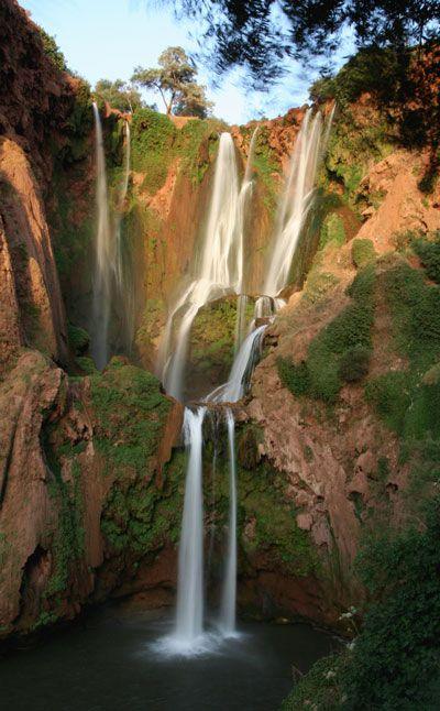 Cascade Ouzoud, Morocco. I stayed at the top of this 3 tier waterfall for 50 cents/night. I swam in the cascades, watched the squirrel monkeys play and cliff dove by day then sat around a large fire listening to locals play their drums and ate tagines by night. I was also offered camels for my sister by a local. Great times!