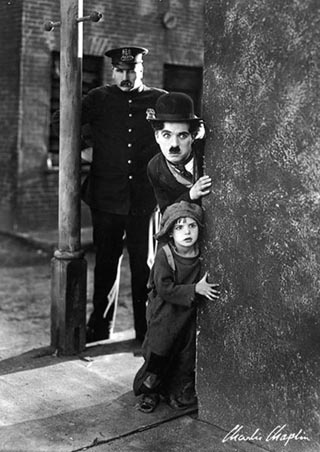 Charlie Chaplin in 'The Kid' (1921) - one of my favorite movies of all time!!!  One of the rarest of films that leaves you laughing and crying at the same time!