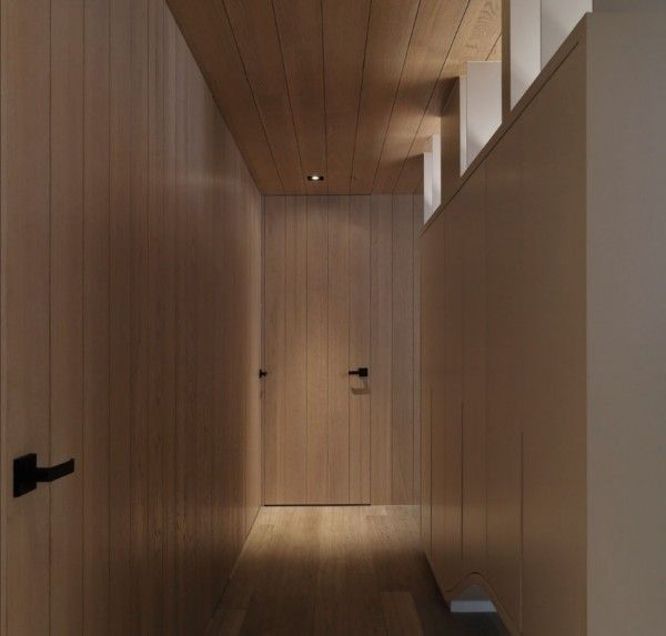 The hallway creates a smooth organic transition between the bedrooms and bathroom.