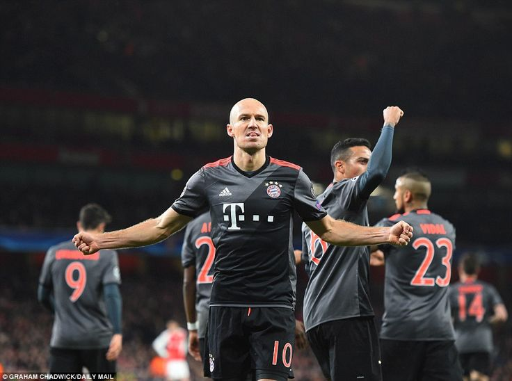 Robben celebrates by pumping his chest out in front of the Bayern supporters as his team-mate trudge back to their half
