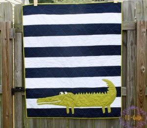 Love the simple design.  Would be cute with any type of large applique in place of the alligator.  Ta Dah!: Mr. Alligator quilt by KD · Quilting | CraftGossip.com