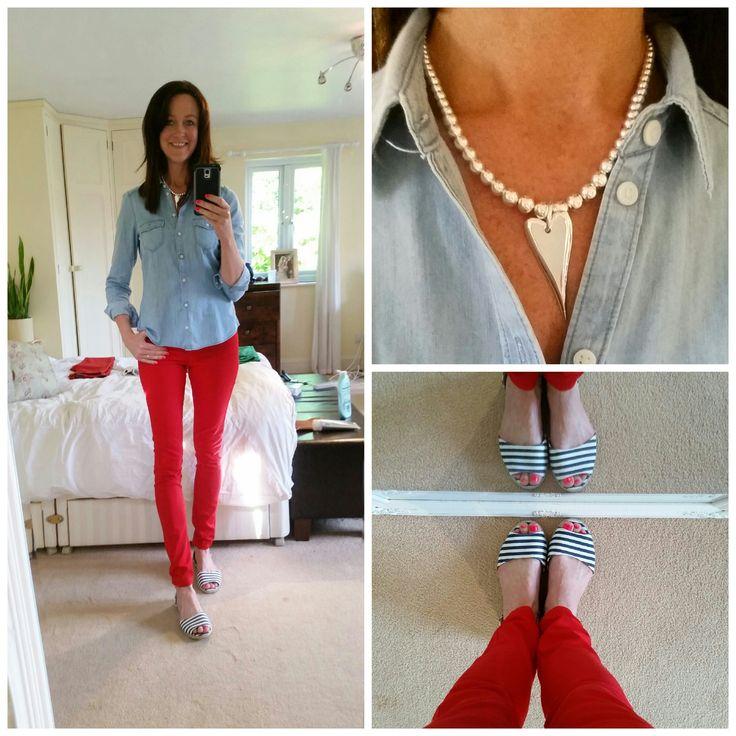Red jeans, denim shirt. Jewellery via Avenue 57: http://shop.avenue57.com/