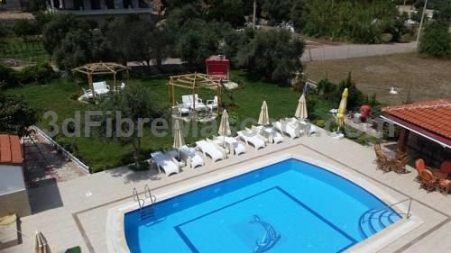 Gökmen Apartments Turunc Offering a garden, Gökmen Apartments is set in Turunc, 9 km from Marmaris. Rhodes Town is 36 km away. Free WiFi is provided throughout the property. All units have a flat-screen TV. There is also a kitchenette, fitted with a toaster and fridge.
