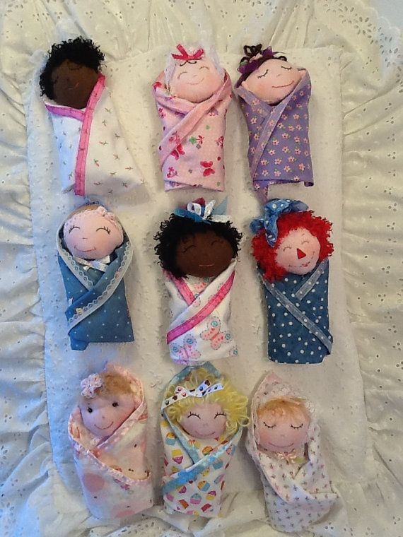 "Cuddly 8"" Swaddle Baby First Doll Pattern with permanently attached blanket includes 9 different faces and 9 different hairstyles. All variations are included in this pattern. Combine these hair and face patterns with your favorite fabrics or fabric scraps and colors in any way you choose for endless possibilities! Great beginner sewing pattern for cloth dolls. These Swaddle Baby Dolls are just like potato chips...You cant make just one! :o) Full size pattern pieces, just print, cut an..."
