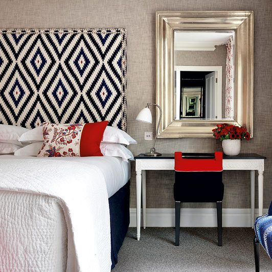Bedroom- love the use of patters and the bright splash of red