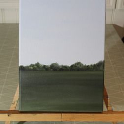 A plain field with a forrest in the background. Green and grey. Painted with water soluble oil paint.