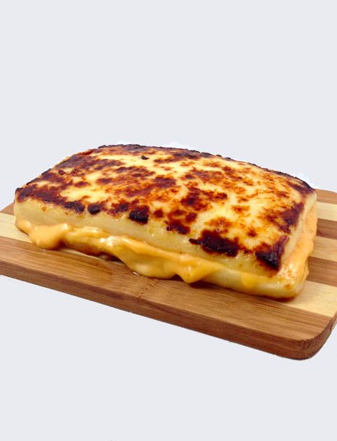 Grilled cheese sandwich made with 100% cheese!! Noble view creamery in southeast Wisconsin sells this cheese for the outside and stick a slice of American cheese in the middle! Mm mm good!