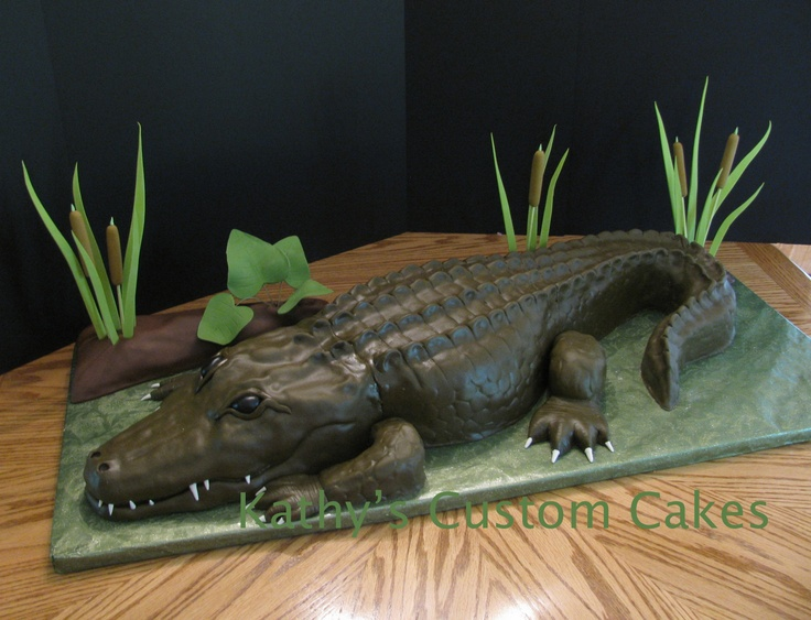 "Louisiana Alligator - My alligator cake.  He was about 3 feet long.  He is covered in fondant...do you like that nice ""swampy"" color?  Yeah, I had trouble with that.  I think alligators call for airbrushing! : )  His teeth and toe nails are gumpaste.:"