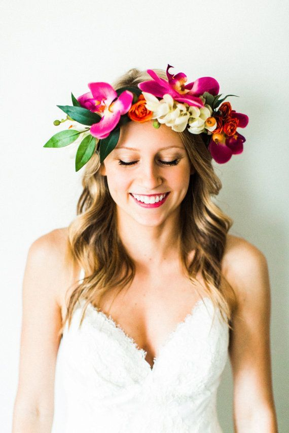 orchids, alpinia, ranunculus, + orange berries make up this colorful + tropical-inspired flower crown. perfect for beach destination #hawaii #weddingdress #weddings