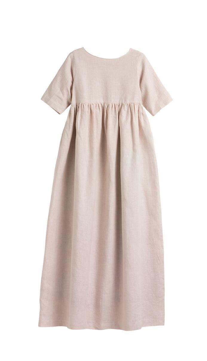 Original vestido de comunión ívory en tono rosa. Moda infantil.