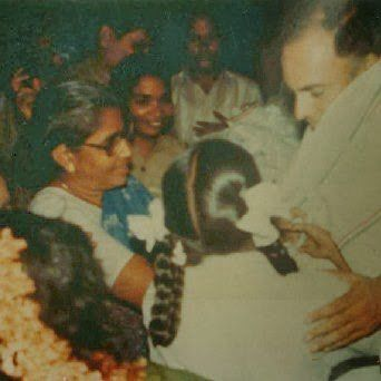 Perhaps the last photo of Rajiv Gandhi moments before he was assassinated by a suicide bomber in Sriperumbudur in Tamil Nadu in 1991. He was campaigning for the elections, when supporters came and offered garlands. The assassin, Dhanu, got near him, bent down to touch his feet and detonated the bomb she was wearing. It killed her, Gandhi and 14 more people. Her head can be seen partially in this photo.