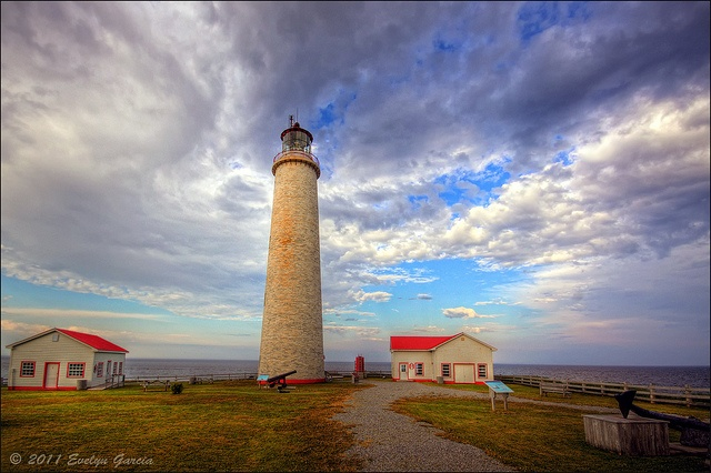 Cap-des-Rosiers Lighthouse, Gaspe, Quebec, Canada    Canada's tallest lighthouse, it soars 34.1 metres (112 feet) into the air. With white marble walls over 2.1 metres (7 feet) thick at the base and tapering to 0.9 metres (3 feet) at the top of the tower, it stands on a foundation rooted 2.4 metres (8 feet) deep in the soil. Its powerful light, perched 41.4 metres (136 feet) above the sea, has guided ships without fail since the lighthouse was built. Evelyn, photographer