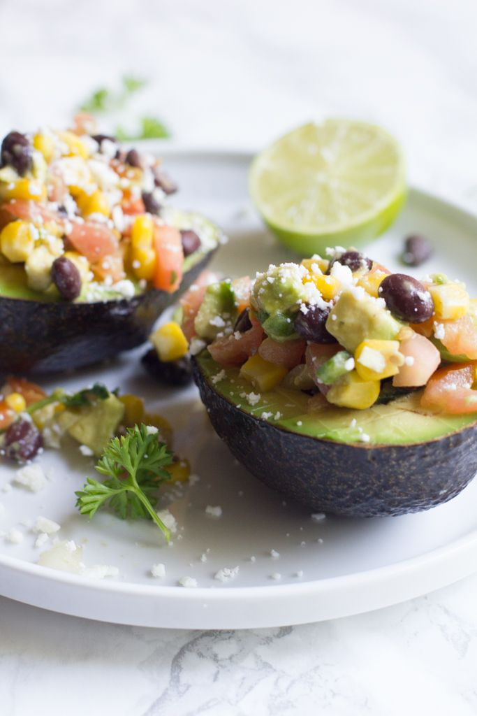 Avocado stuffed with my favorite veggies and beans makes for the perfect mid-afternoon or post-workout snack. Click for recipe.