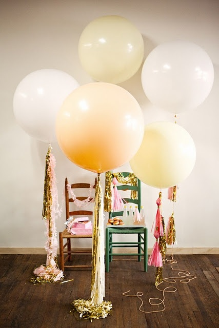 party balloons. Use large tails of tinsel and inexpensive tassels from the craft store as weights for a very expensive look to be reused again and again.