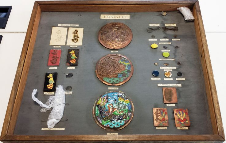 This display case, missing some pieces, illustrates techniques for two types of enamelling: cloisonné and champlevé. It includes an explanation of materials and shows step-by-step instruction. Archive reference: NMC/1622