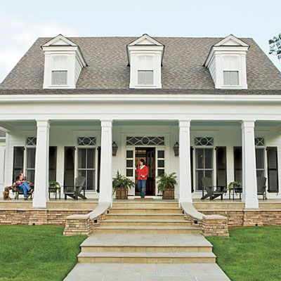 Lovely porch with tapered columns and floor-to-ceiling windows!