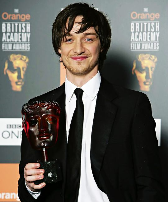 """mcavoyclub: """" Actor James McAvoy poses with The Orange Rising Star Award at The Orange British Academy Film Awards (BAFTAs) at the Odeon Leicester Square on February 19, 2006 in London, England. """""""