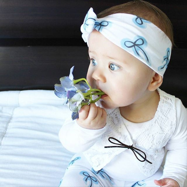 Those baby blues  Norah looks pretty as a picture in our new blue bows!