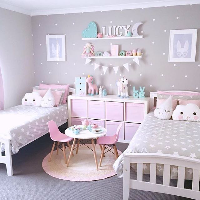 Super cute pink, grey and turquoise girl's shared bedroom with polka dot  wall decals, and cloud and raindrop cushions.
