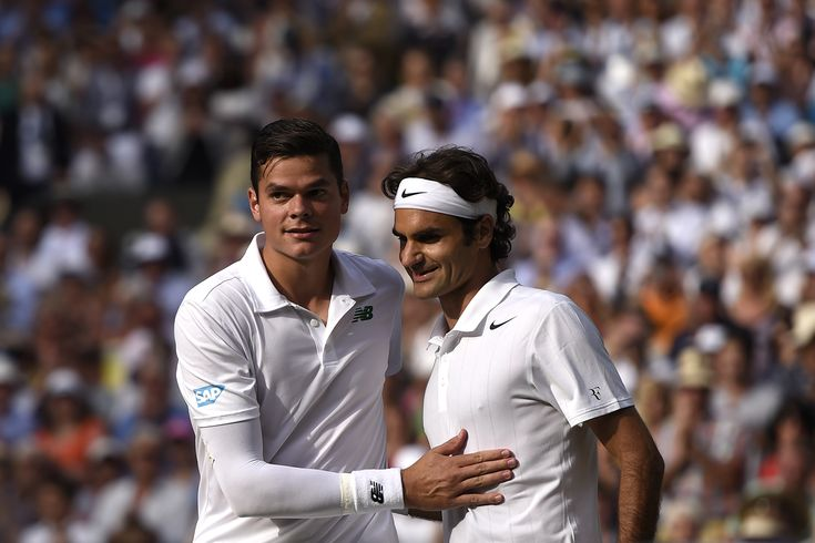 Milos Raonic and Roger Federer after their match on Centre Court - Florian Eisele/AELTC