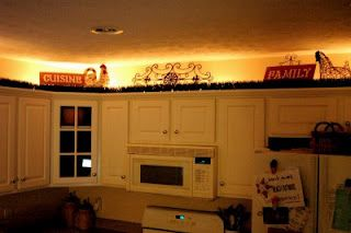 lighting above cabinets...using 24 foot rope light ($15.00)