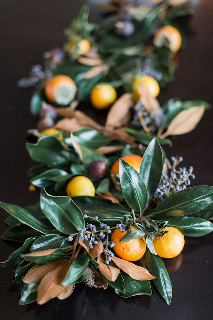 Table Garland with magnolia berries, clementines, and kumquats Magnolia and Fruit Garland by JM Flora