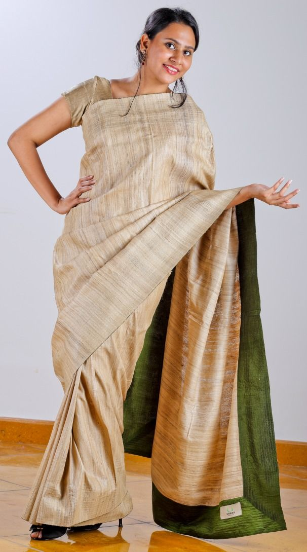 Tussar Silk Saree with leaf green pure silk facing teamed with geometric [ window grill inspired] screen printed Silk blouse.  SHOP AT www.ubikaa.com