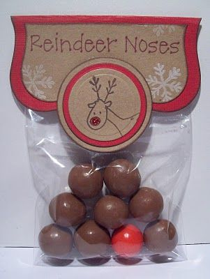 Malt ball for the brown and gum ball for the red nose :)
